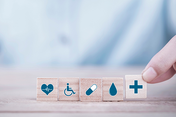 Small wooden tiles with health icons