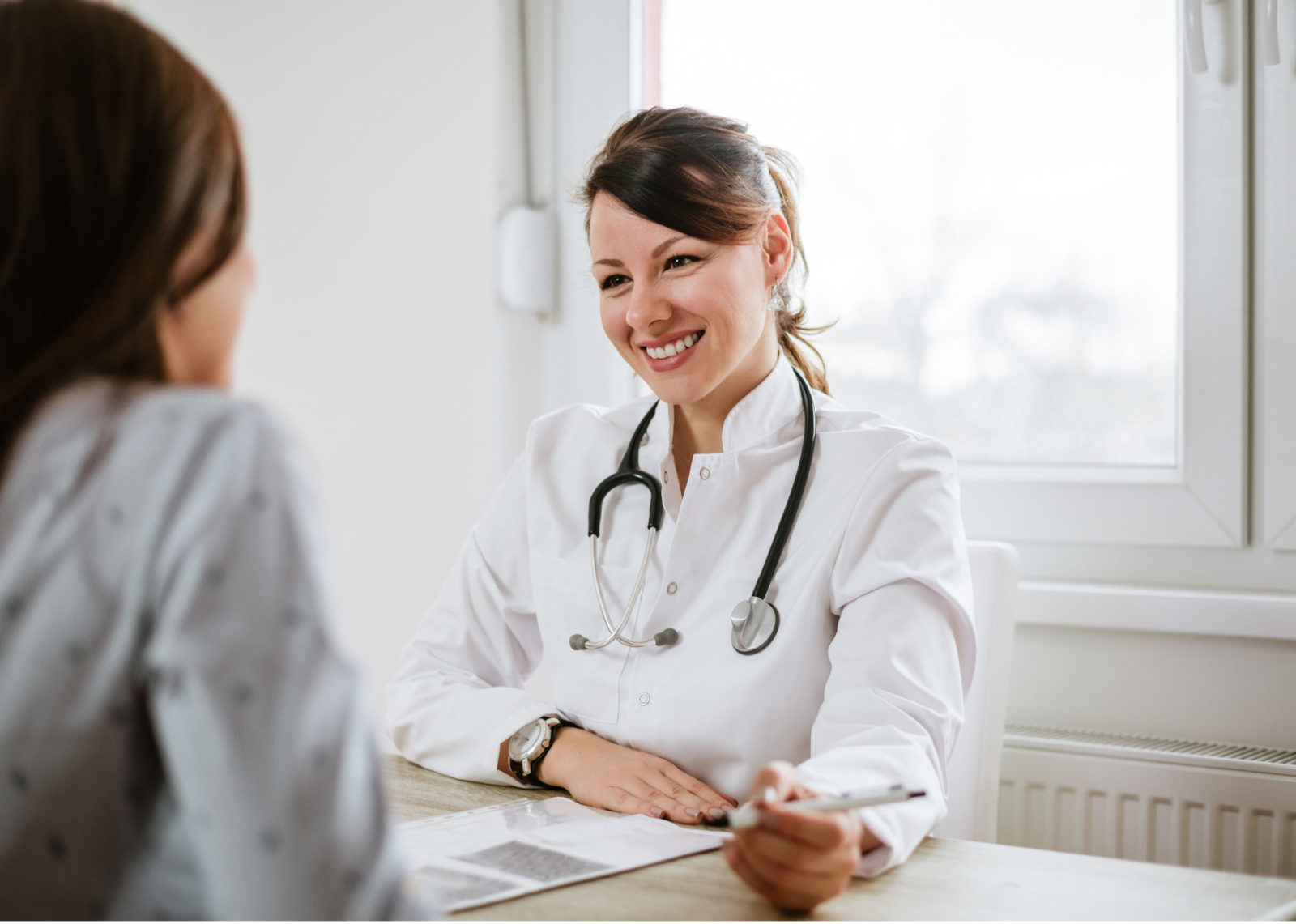 Female doctor meets with patient