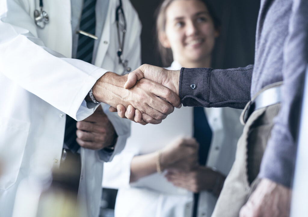 Doctor shaking hands with patient after providing value-based care